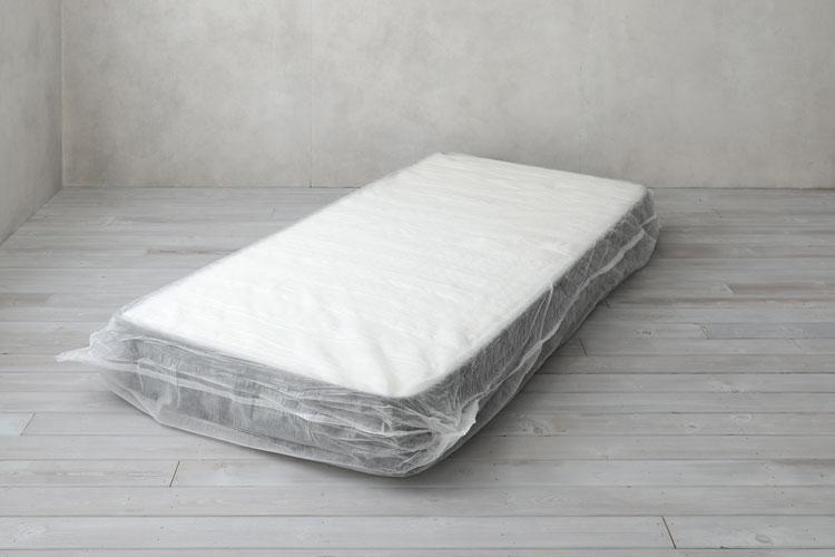 不織布に包まれたマットレス